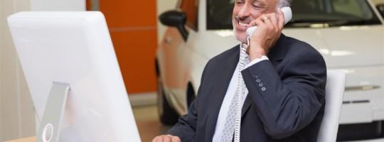 dealer-on-phone-736x490